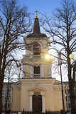 Belltower of Holy Trinity Church, Helsinki. Was built in the neo classical style in 1826.  Royalty Free Stock Photo