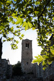 Belltower and leaves. Backlit of the belltower of Monastery of Hosios Loukas - Greece - in the leaves of plane tree royalty free stock photography