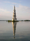 Belltower in the middle of lake Stock Images