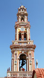 Belltower Monastery  Panoramitis on the Greek island of Simi Royalty Free Stock Images
