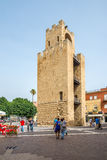 Belltower of Oristano at Mannu square in Sardinia. ORISTANO,ITALY - SEPTEMBER 20,2014 - Belltower of Oristano in Sardinia. Was built in 1290, is 19 metres tall stock image