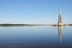 Belltower on river Volga, Kalyazin, Russia Stock Photos