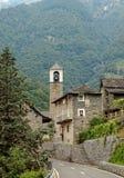 Belltower - San Bartolomeo. Belltower of the rural village San Bartolomeo in the Verzasca Valley, Switzerland Royalty Free Stock Photos