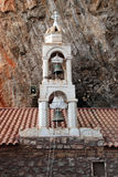 Belltower Saint Dimitrios Monastery in the  mountains , Greece Stock Photo