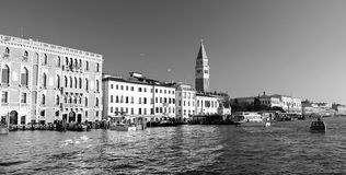 Belltower of saint mark and venetian houses in venice Royalty Free Stock Photography