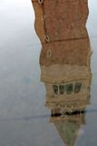 Belltower of Saint Mark in Venice reflected on a puddle Stock Photography