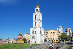 Belltower of the Samara Iversky Monastery in the sunny day. Samara. Belltower of the Samara Iversky Monastery with the gateway temple for the sake of the prelate Royalty Free Stock Image