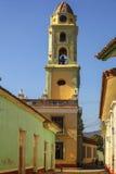 Belltower in Trinidad, Cuba. Beautiful Colonial church with belltower along a cobblestone street in Trinidad, Cuba stock photo