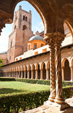 The belltower. The view on the belltower of Monreale cathedral from the courtyard with great columns. Sicily royalty free stock photos