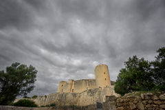 Bellver Castle in Majorca at sunset. Wide angle view of Bellver Castle at sunset in Majorca Stock Images