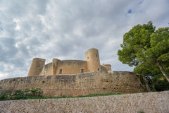 Bellver Castle in Majorca, wide angle. Wide angle view of Bellver Castle against cloudy sky in Majorca Royalty Free Stock Images