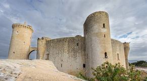 Bellver Castle in Majorca, wide angle. Wide angle view of Bellver Castle against cloudy sky in Majorca Royalty Free Stock Photo