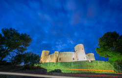 Bellver Castle by nigh in Majorca, wide angle. Night view and wide angle of Bellver Castle against cloudy sky in Majorca Stock Images