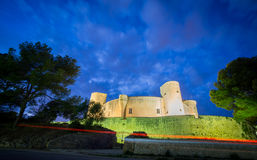 Bellver Castle at sunset in Majorca, wide angle. Wide angle of Bellver Castle against cloudy sky at sunset in Majorca Stock Photos