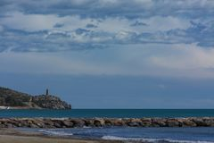 Beach, breakwater and tower a clear day stock images