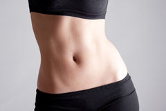 Belly. Body parts: Athetic Woman's belly Stock Photo