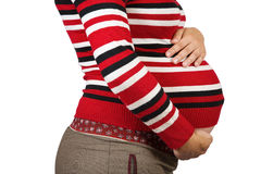 Belly of 9 months pregnant woman. Over white Royalty Free Stock Images