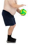 Belly, ball and scales. Obese man stands on weight scales with ball on a white background Royalty Free Stock Photo