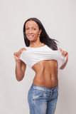 Belly of a beautiful woman on white background Stock Image