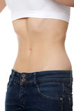 Belly of beautiful young female with anorexia royalty free stock photos