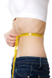 Belly of beautiful young female with anorexia Royalty Free Stock Images