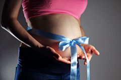 Belly with blue bow Stock Image