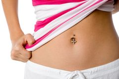 Belly Button. A woman shows off her belly button piercing Stock Photos