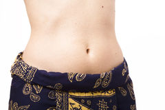 Belly button. Sarong showing off woman's belly button stock image