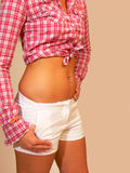 Belly button jewelry. A nice diamond ring on the belly button of a young women Stock Photo