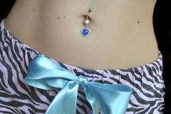 Belly button piercing royalty free stock photo