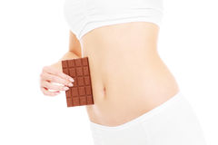 Belly and chocolate Stock Photo