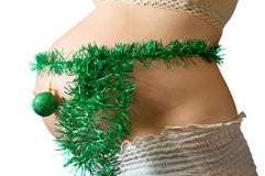 Belly with christmas decorations Royalty Free Stock Image