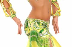 Belly dance. The woman dancing belly dance in traditional costume, body part Stock Image