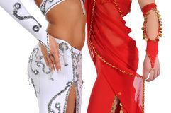 Belly dance. Two woman dancing belly dance in traditional costume, body part Royalty Free Stock Photo