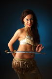 Belly dancer. Holding a sword on her side Royalty Free Stock Photos