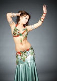 Belly-dancer. Attractive belly-dancer woman in stylized easter clothing and make up Royalty Free Stock Image