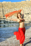 Belly dancer. Beautiful belly  dancer on the ancient stairs of  Kurion amphitheatre in Cyprus Stock Photo