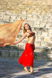 Belly dancer. Beautiful belly dancer  on the ancient stairs of Kourion amphitheatre in Cyprus Royalty Free Stock Photos