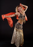 Belly dancer. Young blonde belly dancer in black stock photography