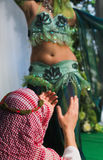 Belly dancer. Male Clap dancer performing the dance belly Stock Image