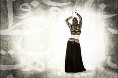 Belly dancer in an abstract arab space Stock Image