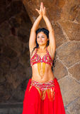 The belly dancer. BARCELONA, SPAIN -AUG 29, 2009: Unidentified beautiful wooman, belly dancer performer giving show for tourists in the famous Guell park in stock photos