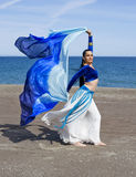 Belly Dancer on a Beach. On asunny day Stock Photo
