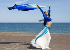 Belly Dancer on a Beach. On a sunny day Royalty Free Stock Photo