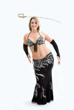 Belly dancer in black. Beautiful belly dancer in black outfit balancing sword, isolated Stock Image