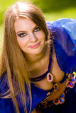 Belly Dancer in Blue. Lovely young woman dancing belly dance in blue outdoors Stock Image