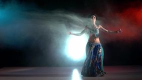 Belly dancer in a blue stage costume dancing in stock footage