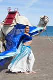Belly Dancer and Camel. Belly Dancer with a Camel on a Beach Stock Image