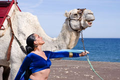Belly Dancer and Camel. Belly Dancer with a Camel on a Beach Stock Images