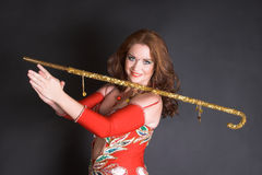 Belly Dancer with cane. Belly dancer with tribal cane decorated in gold stock photos